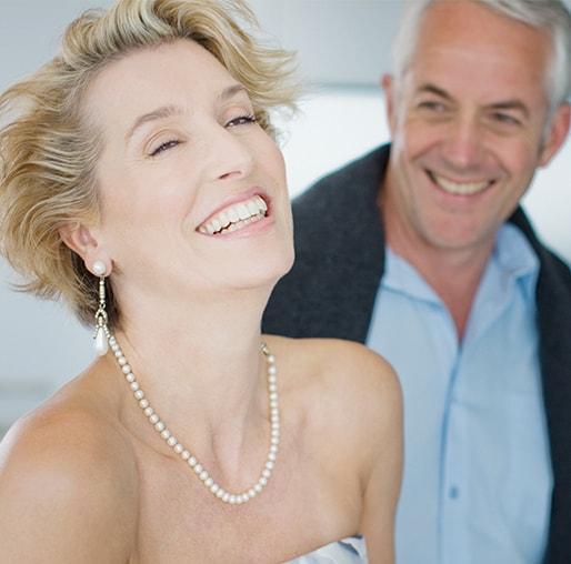 Elegant, smiling older couple