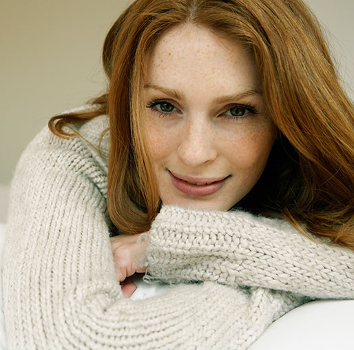 Relaxed red headed woman smiling